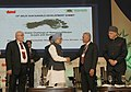 Manmohan Singh shaking hand with the Kiribati President, Mr. Anote Tong, at the 13th Delhi Sustainable Development Summit, in New Delhi. The Union Minister for New and Renewable Energy, Dr. Farooq Abdullah is also seen.jpg