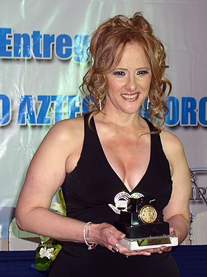 "Manoella Torres - Manoella Torres being awarded as ""Star of the Century"" with the ""Golden Aztec Calendar"" by the Mexican Association of Journalists of Radio and TV"