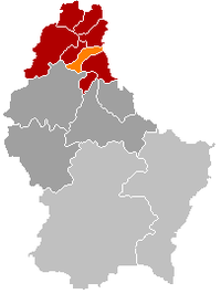 Map of Luxembourg with Munshausen highlighted in orange, the district in dark grey, and the canton in dark red