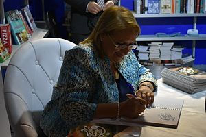 Marie-Louise Coleiro Preca - Coleiro Preca, as President, signing books at the MCC in Valletta