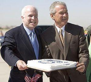 Senate career of John McCain, 2001–2014 - President George W. Bush presenting birthday cake to Senator McCain. Luke Air Force Base, August 29, 2005.