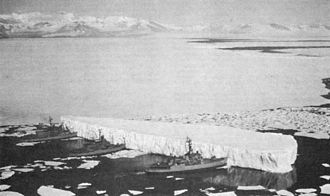 Iceberg - An iceberg being pushed by three U.S. Navy ships in McMurdo Sound, Antarctica