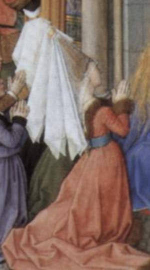 "Hennin - French hennin of c.1460 is worn with several white veils, one reaching to the face (nb the white crescent at the tip of the ""steeple"" belongs to the figure behind)"