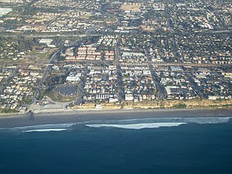 Encinitas, California - Aerial view of part of old town Encinitas showing Moonlight Beach on the left. Parallel with the shore is Historic Coast Highway 101, also parallel and further inland is Interstate 5 in California
