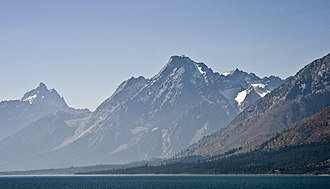 Mount Moran - Mount Moran rises abruptly above Jackson Hole. Grand Teton can be seen in the background at left