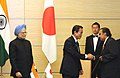 Mukesh Ambani presenting the 2nd India-Japan Business Leaders Forum Jt. Report (Draft) to the Prime Minister of Japan, Mr. Taro Aso in presence of the Prime Minister, Dr. Manmohan Singh, in Tokyo, Japan on October 22, 2008.jpg