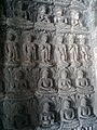 Multiple depictions of Buddha on a wall at Ajanta Caves.jpg