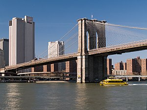 The western ramp and pylon of Brooklyn Bridge,...