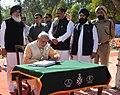 Narendra Modi signing on the visitors' book at Main Samadhi Sthal of National Martyrs, at Hussainiwala, in Punjab. The Chief Minister of Punjab.jpg