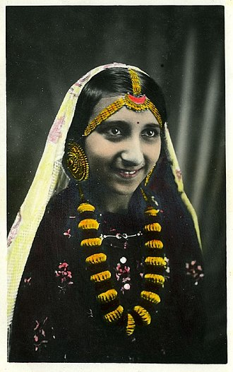 Pahari people - A Nepalese Pahari woman on 1900s in her traditional dress
