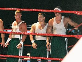 Nick Nemeth, Michael Brendli, and Ken Doane during a tag team match.jpg