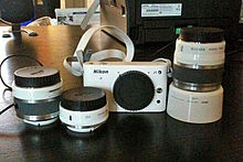 Nikon 1 J1 white with lenses.jpg
