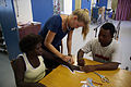 Occupational Therapist Melanie Glapa works with student George Hage to assist hand therapy patient 'Pemoli' at the physiotherapy ward at the National Referral Hospital, Honiara. (10711262355).jpg