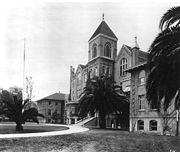 "The first true library was housed in the College of Liberal Arts Building (""Old College""), which was built in 1884, and designed to hold the entire USC student body—55 students. Two wings were added to the original building in 1905.  Bovard Hall can be seen to the south in the back left of the picture."