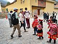 Ollantaytambo Peru- indigenous children begging tourists to give them money for photo.jpg