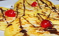 Pancakes with chocolate syrup, hazelnuts, and cherries 01.jpg