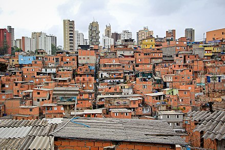 Favela of Paraisopolis, in the district of Vila Andrade, with residential buildings in the background. Paraisopolis I.jpg