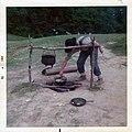 Park prepares campfire at Vicksburg Military Park (1975).jpg