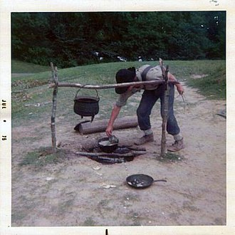 Vicksburg National Military Park - Park ranger prepares meal in campfire demonstration at Vicksburg National Military Park (1975).