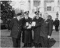 Photograph of President Truman on the White House grounds receiving honorary bades from the Washington Metropolitan... - NARA - 200415.tif
