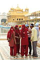 Pilgrims inside the Golden Temple (9693310904).jpg