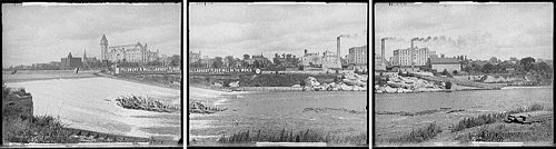 "panorama seen from west side of river looking east, large sign or banner says ""Pillsbury A Mill, Largest Flour Mill in the World"""