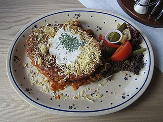 Goulash - Polish potato pancake and spicy goulash with sheep milk cheese and sour cream