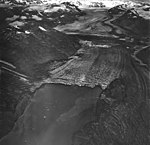 Plateau and Carroll Glaciers, terminus of tidewater glacier with dark lateral moraines, August 25, 1968 (GLACIERS 5785).jpg