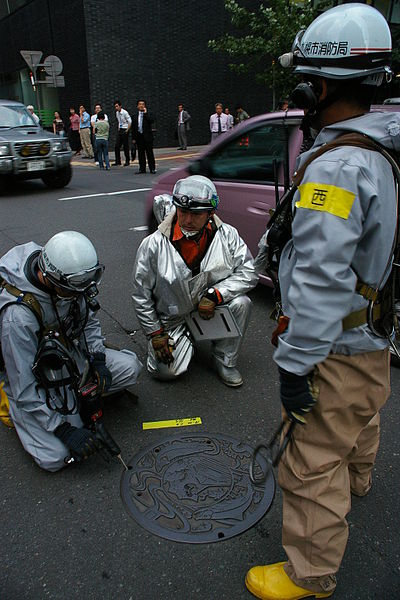 Firefighters detecting toxic gas