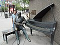 Posing beside an interesting piano diorama outside the National Arts Centre, Ottawa (20563749570).jpg