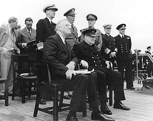 Roosevelt and Winston Churchill meet at Argentia, Newfoundland aboard HMS Prince of Wales during their 1941 secret meeting to develop the Atlantic Charter.