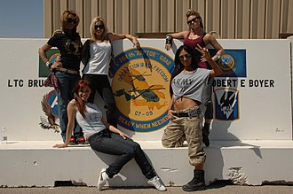 The Pussycat Dolls - The Pussycat Dolls pose in front of an Operation Iraqi Freedom unit seal at Camp Buehring, Kuwait, on March 10, 2008. (L–R): Melody Thornton, Jessica Sutta, Ashley Roberts, Nicole Scherzinger and Kimberly Wyatt.