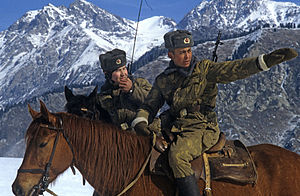 Border guard - Soviet Border Troops riding horses patrol a mountainous section of the border in 1984.