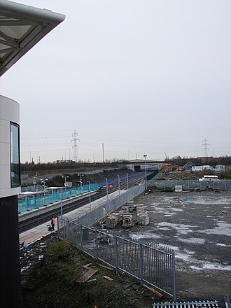 Park West and Cherry Orchard railway station - A view of Park West and Cherry Orchard station looking westwards towards the bridge on the M50 motorway.