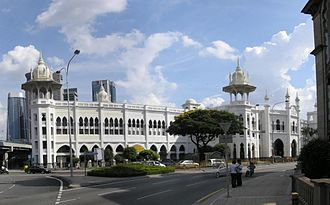 "Kuala Lumpur railway station - The 1986 renovation also extended the old station's frontal facade, with the existing northern wing masked by a ""Raj""-styled edifice."