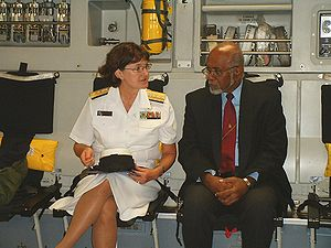 Joint POW/MIA Accounting Command - Navy Rear Adm. Donna Crisp, commander, Joint POW/MIA Accounting Command, talks with Vanuatu President Kalkot Mataskelekele at a repatriation ceremony in 2009.