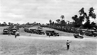 Military logistics - Red Ball Express - Trucks moving through a Regulating Point - 1944