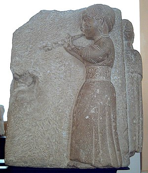 Turdetani - High-relief showing an Auletris (woman playing an aulos). Ancient Iberian artwork sculpted in limestone at the end of the 3rd or the beginning of the 2nd century BC. It is part of the so-called Sculptures of Osuna, Seville Province, Andalusia, Spain.