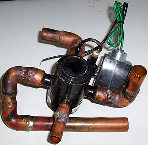 A Reversing Valve Removed From An Hvac Heat Pump For Replacement