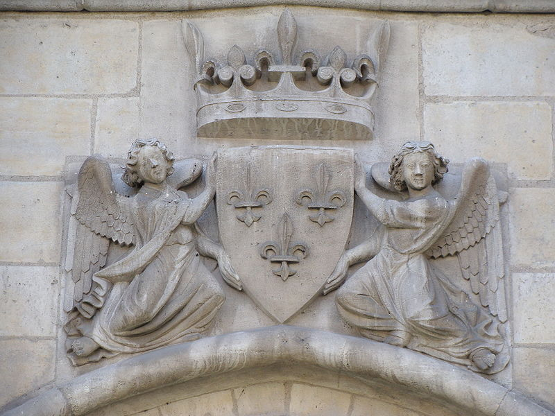 Royal coat of arms of France. Relief on the main gate of Château de Vincennes, east of Paris.