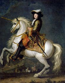 Louis XIV of France riding a white horse that is rearing up in the air.