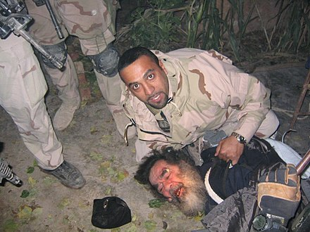 Saddam Hussein being pulled from his hideaway in Operation Red Dawn, 13 December 2003 SaddamSpiderHole.jpg