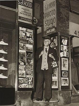 "Sam Hood - Sam Hood outside his ""Dalny Studios"", 124 Pitt Street, Sydney, 1953 (taken just three weeks before his death)"