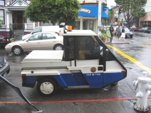 Parking enforcement officer - A parking attendant vehicle in San Francisco.