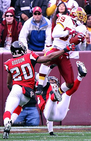 Santana Moss - Moss makes a mid-air catch in a 2006 game against the Falcons with Allen Rossum in pursuit.