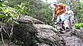 Scrambling over a boulder. Cattail Peak hike, June, 2010 (4703252345).jpg