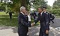 Secretary of Defense Chuck Hagel shakes hands with President Barack Obama.jpg