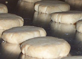 Shortbread - Fully cooked shortbread rounds on a baking sheet