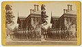 Shows a line of uniformed guards standing at attention in Fairmount Park, Philadelphia, late nineteenth-century. The guards stand in front of the Sedgley Guard House. (9045460852).jpg