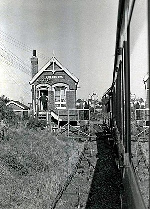 Knockmore railway station - Knockmore Jct. Signal Cabin in 1977, with a single line token being surrendered to the signalman on a Lisburn-Antrim railway line working from Antrim back to Lisburn.